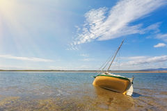 Boat moored on shallow waters of Sandy Point, Australia. Boat moored on shallow waters of Sandy Point, Victoria, Australia stock photo