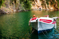 Boat moored at the shore of the lake Stock Photos