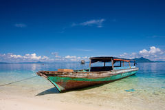 Boat moored by the shore on a tropical island Stock Image