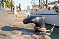 Boat moored to a ship bollard Royalty Free Stock Photos