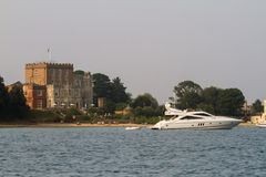 A boat moored up near brownsea castle in Poole harbour Royalty Free Stock Image