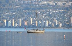 Shelter in an Expensive City. A boat moored in the Vancouver harbor, one of the most expensive cities in the world, provides temporary and affordable shelter Stock Photos