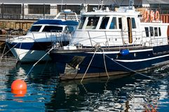 Boat at a mooring. The boat costs at a seaport pier Royalty Free Stock Image