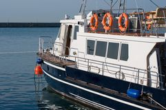 Boat at a mooring. The boat costs at a seaport pier Stock Photo