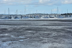Boat mooring at low tide Stock Photo