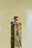 Boat Mooring post in river Stock Images
