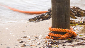Boat mooring tied to post Royalty Free Stock Images