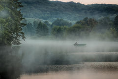 Boat in the morning fog. Lonely boat on a slow river in the morning mist Stock Images