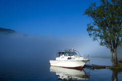 Boat in morning mist Stock Images
