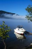 Boat in morning mist Royalty Free Stock Photos