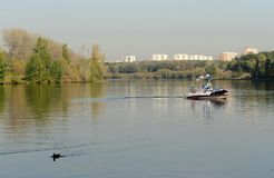 Boat on the Moscow River in the Silver Forest. Royalty Free Stock Images