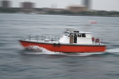 Boat in motion. Boat Cruising at high speed Stock Photography