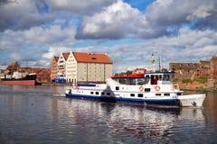 Boat in Motlawa river in old town of Gdansk. Motlawa river side in old town of Gdansk, Poland Stock Photo