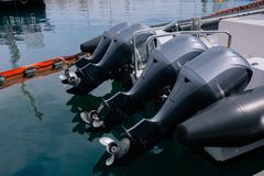 Boat motor black motors installed on the yacht royalty free stock photography