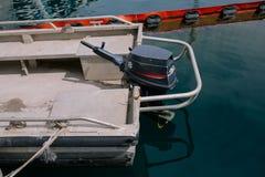 Boat motor black motors installed on the yacht royalty free stock photo