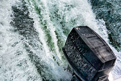 Boat motor pushing water in lake Royalty Free Stock Photo