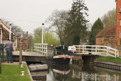 Boat motoring through canal lock Stock Image