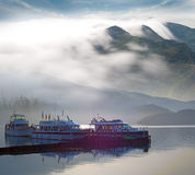 Boat, mountain and cloud for travel background Stock Photography