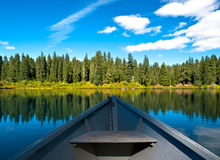 Boat on Mountain lake in forest Stock Image