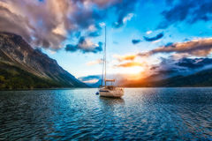 Boat in mountain lake Stock Photography