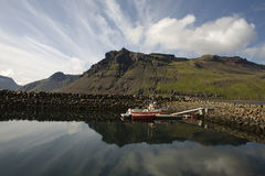 Boat,mountain, reflection in Iceland Royalty Free Stock Images