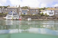 Boat in Mousehole Harbour. A couple of fishing boats in Mousehole Harbour, on a calm summer`s day Royalty Free Stock Photo