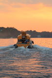 Boat moving at sunset royalty free stock photo
