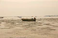 A boat on the mud Stock Photography