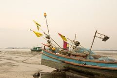 A boat on the mud Stock Image