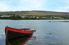 Boat, Mulranny, County Mayo Ireland. A red fishing boat fills with water in Mulranny, Ireland Stock Photo