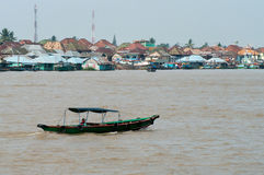 Boat on Musi River  in Palembang, Sumatra, Indonesia. PALEMBANG, INDONESIA - JULY 30 : Boat on Musi River July 30, 2011 in Palembang, Sumatra, Indonesia Stock Photos