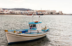 Boat at mykonos harbor Stock Photography