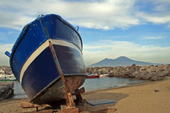 Boat in Naples. A boat on the Mergellina beach with the Vesuvio on the background royalty free stock photography