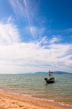 Boat with national flag, beach and sea in Koh Samui, Thailand Stock Photography
