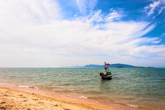 Boat with national flag, beach and sea in Koh Samui, Thailand Royalty Free Stock Image
