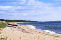 Boat on a natural swedish beach in summertime Royalty Free Stock Photos