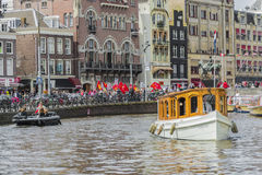 Boat navigating in Amsterdam, Netherlands. AMSTERDAM, NETHERLANDS – JUNE 16, 2013: One of the thousands boats navigating along the famous Amsterdam canals Stock Images