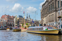 Boat navigating in Amsterdam, Netherlands. Royalty Free Stock Photo