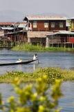 Boat navigating the waters of peaceful Inle Lake in Myanmar (Bur Stock Images