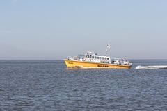 Boat Navy at the Wadden Sea Stock Photos
