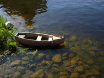The boat near the bank of river. The old boat near the bank of Neva river Royalty Free Stock Photos