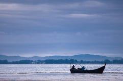 Boat near beach on low tide Royalty Free Stock Photo