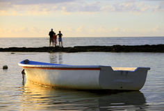 Boat near the beach at sunset Stock Photography