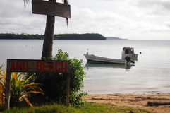 Boat near beach with timber name plate Stock Photography