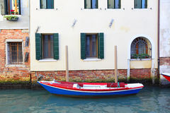 Boat near house Royalty Free Stock Images