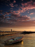 Boat near jetty. Sunset image of magical moment in Grand Cayman Royalty Free Stock Photography