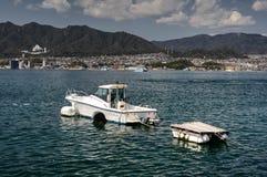 Boat near Miyajima island, Japan. White personal boat in port of Miyajima (Itsukushima) island with view on Hiroshima. Miyajima is a small island less royalty free stock photography