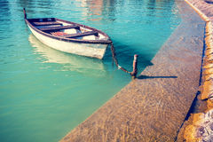 Boat near pier. Landscape with lake and boat. Boat near pier Stock Photo