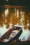 Boat near the river Stock Photos