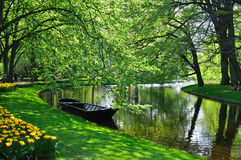 Boat near the river in Keukenhof park Royalty Free Stock Images